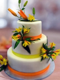 Goodies Bakeshop three tier wedding cake with fresh lilies.