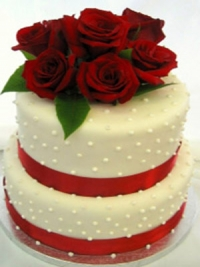 Goodies Bakeshop two tier wedding cake with fresh roses, fondant and handmade pearls.