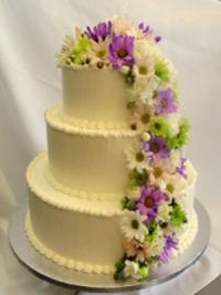 Goodies Bakeshop 3 tier wedding cake, buttercream, fresh spring flowers.